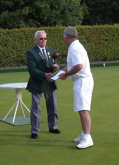 Des Receives the Trophy from Chairman Colin Morphew